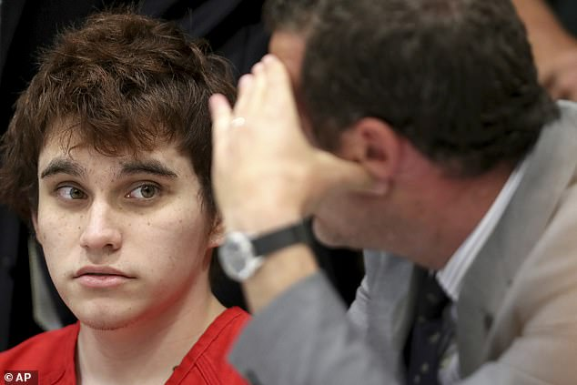 The gunman, Nikolas Cruz (seen left with defense attorney Gabe Ermine in May 2019), killed 17 students and staff and wounded 17 others