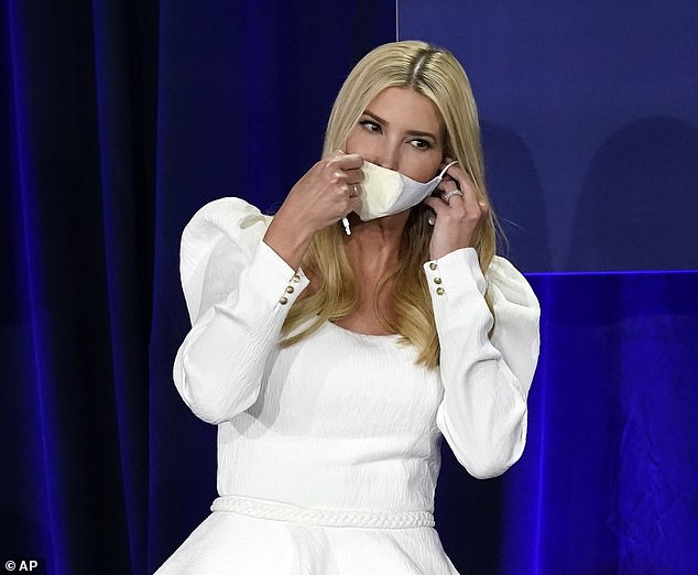 Ready to go: Ivanka took off her mask before sitting down for the roundtable discussion
