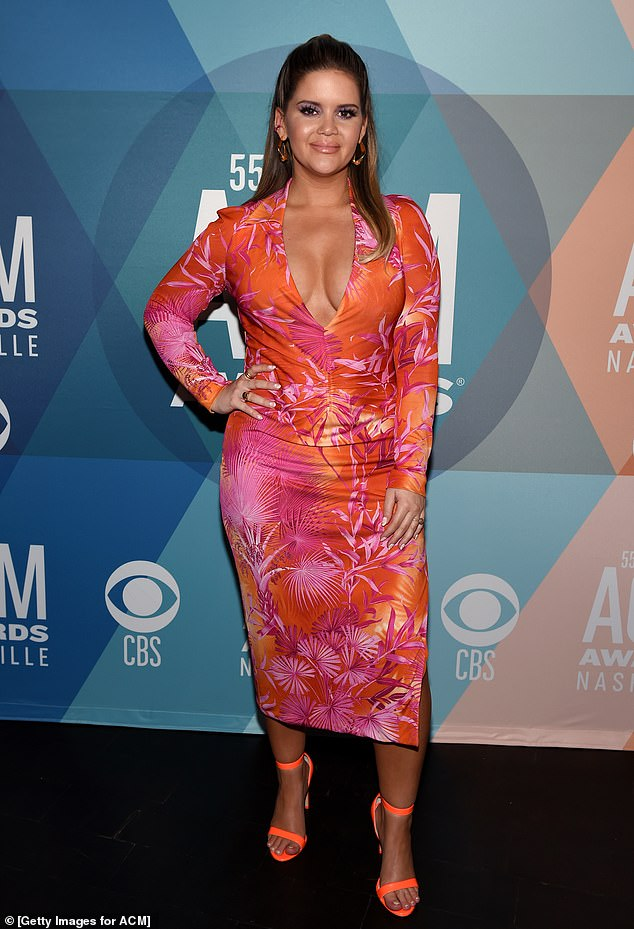 Flower power: Maren Morris, 30, put on a colorful display in a low-cut floral dress at the 55th Annual Academy of Country Music Awards in Nashville on Wednesday