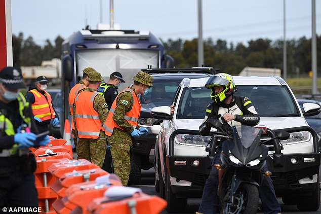 Although there are no actual fences, police will use checkpoints at major highways, automatic number plate recognition and extra patrols. Pictured: A checkpoint in Geelong