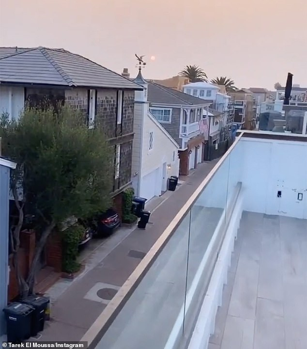 Perfect view: The couple appreciated the great views of the ocean and Newport Beach, even though the sky was filled with smoke from wildfires burning near LA