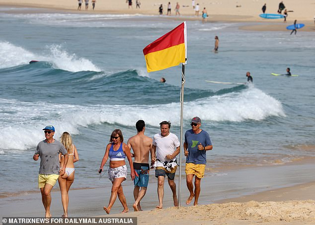 Crowds begin to gather at Bondi Beach in Sydney's eastern suburbs on Thursday morning
