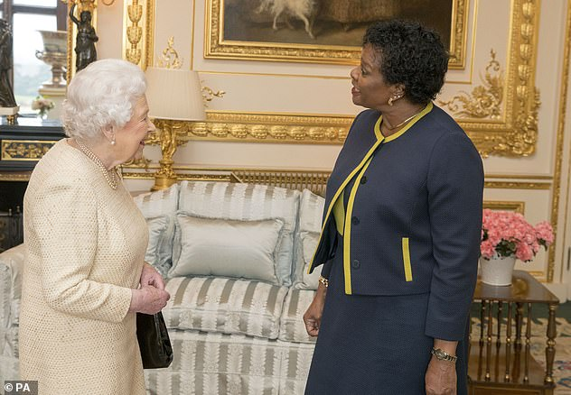 Looking back: The Queen is pictured withGovernor-General of Barbados Dame Sandra Mason at Windsor Castle in 2018