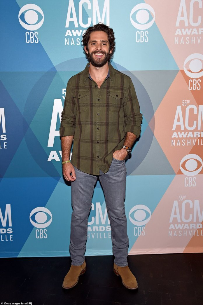Nominated: Thomas Rhett, 30, opted for an unfolded shirt paired with jeans and boots