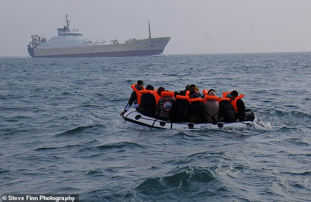 Danger zone: The migrants' boat chugs across the world's busiest sea lane