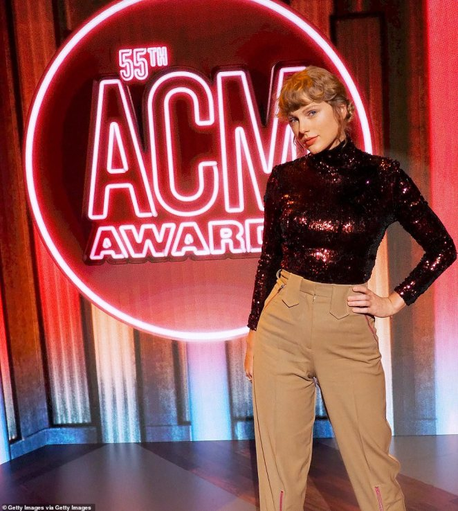 Head-to-toe: Taylor Swiftgraced the socially-distanced carpet for Wednesday's ACM Awards in head-to-toe Stella McCartney at the iconic Grand Ole Opry House