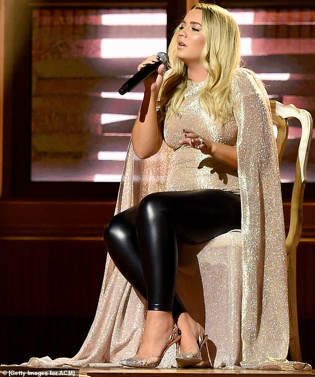 What an ensemble:Her sensational top featured massive robe sleeves that became part of a cape, which flowed to the ground as she sat on her onstage stool