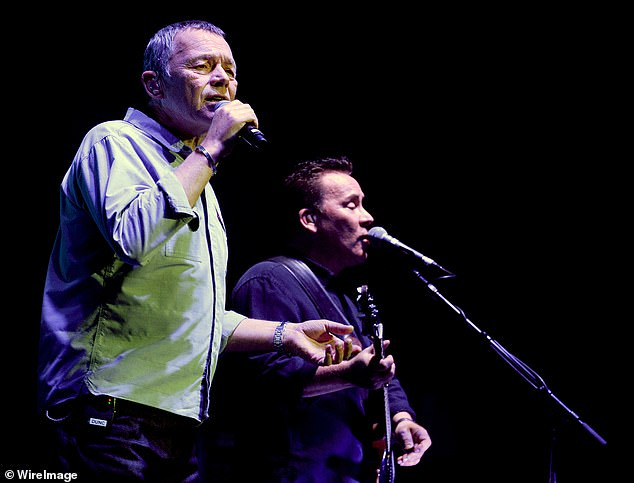 'We'll see you on the other side': British band UB40 is forced to postpone their Australian tour due to COVID-19... after Harry Styles also cancelled. Pictured: Duncan and Robin Campbell from UB40