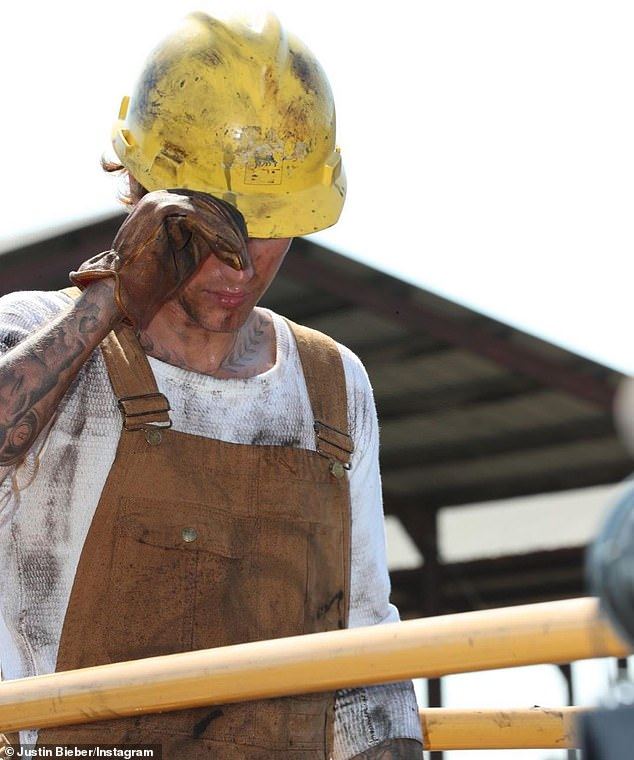 New music: He's since been promoting his upcoming single Holy, posting another greased-up photo of himself Wednesday to Instagram, rocking overalls and a hardhat
