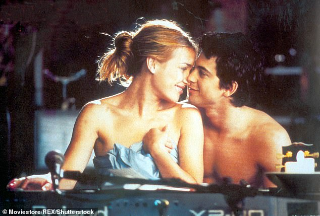 Racy: The memorable scene featured Adam, who portrayed Kevin O'Donnell, do a strip tease on the bar to help love interest, Violet Sanford. Played by Piper Perabo (L)