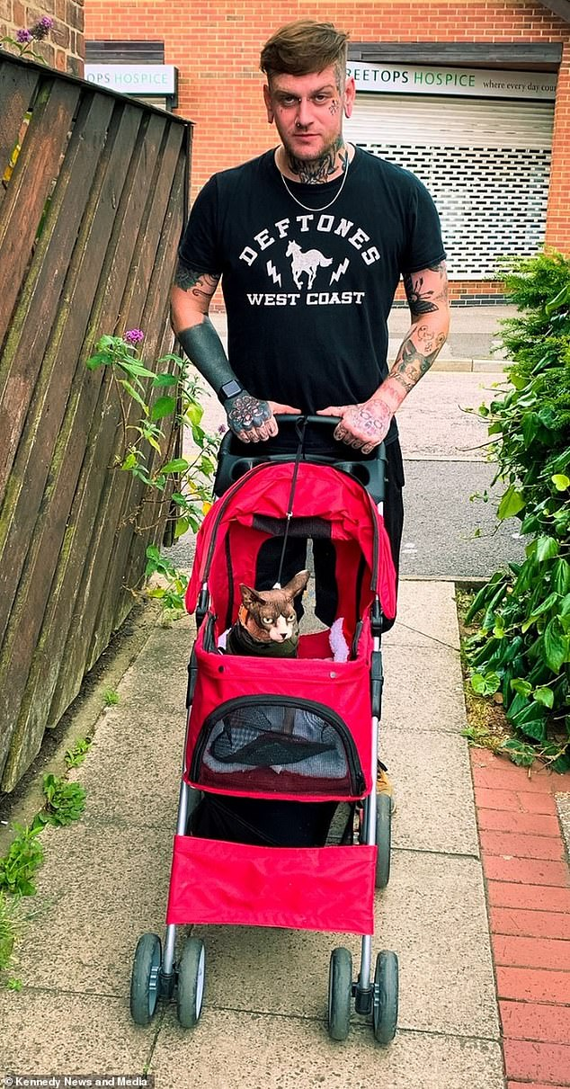 Travelling in style! Biille Jo shares Frank with her housemate and friend Lee Taylor, who ferries the pet around in a snazzy red pushchair