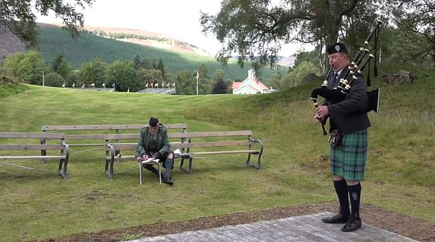 This year the Braemar Games consisted of a series of track, dancing, piping and heavy events took place without an audience. Pictured, Solo Piping with John McDonald playing the 'Lonach Gathering' March, with judge Duncan Watson, a previous gold medal winner in piping