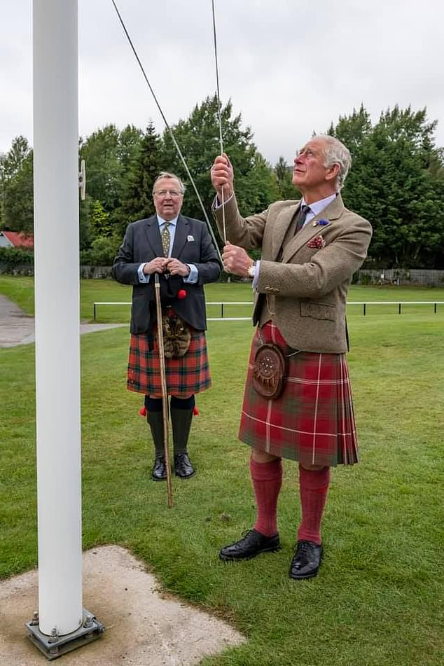 Raising the standard: Charles, 71, known as the Duke of Rothesay in Scotland, was on hand to raise the standard as a small group gathered to compete behind closed doors in a pared-back version of the Braemar Games, one of 60 Highland Games cancelled due to the virus