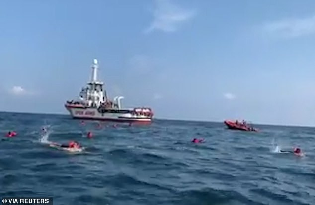 Desperate migrants jumped from the Spanish rescue vessel Open Arms on Thursday in an attempt to swim to the Sicilian City of Palermo