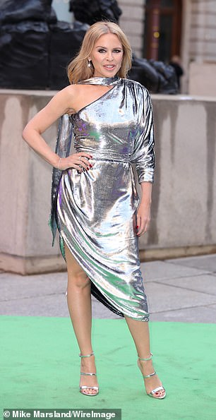 Asilver Ralph and Russo liquid velvet asymmetric dress worn by Kylie Minogue to the Royal Academy Summer Party in 2019 sold at £1,375