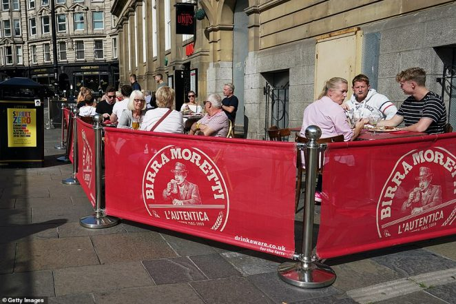 People sit outside a pub and restaurant near to the River Tyne on September 17, 2020 in Newcastle upon Tyne today