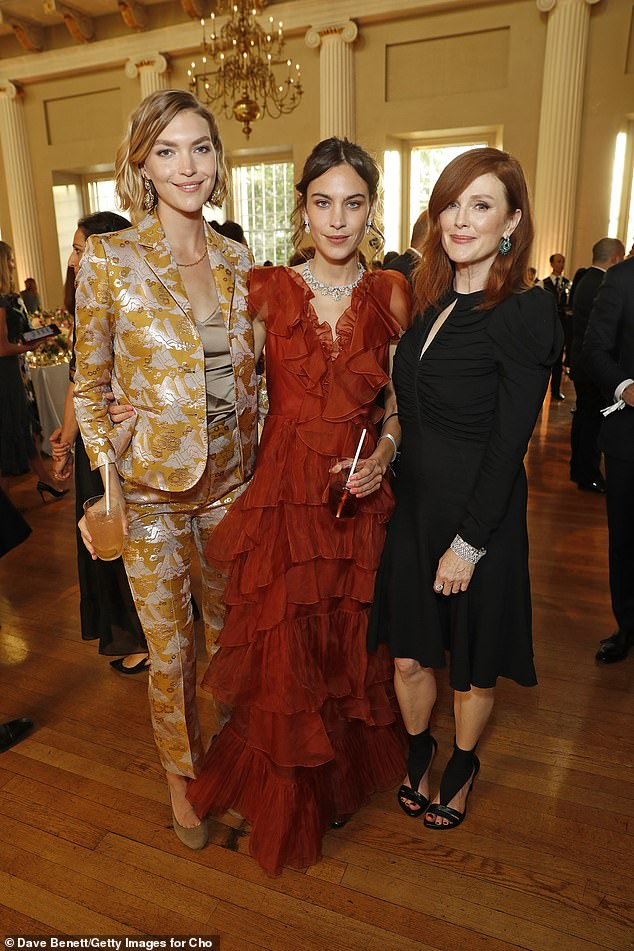 Alexa Chung's (middle) 'Melancholy Dance' rust silk organza dress by Johanna Ortiz, which she wore to the Chopard Bond Street Boutique reopening event in London in June 2019,sold for £1,250