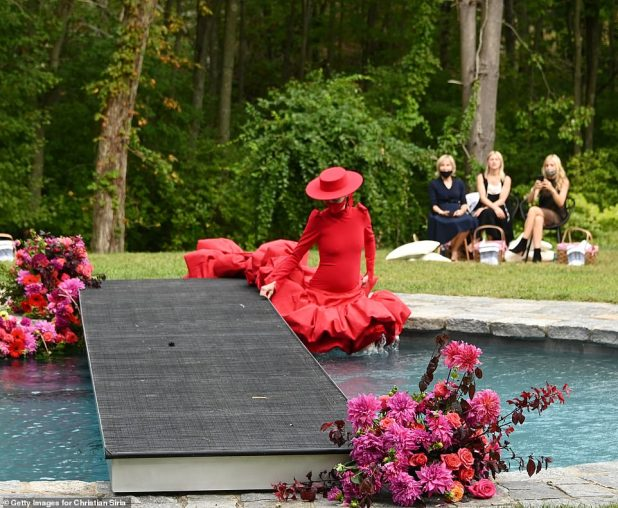 Her feet got wet: The Canadian model, 32, stopped the incident by rolling in the pool when she saw the guests.