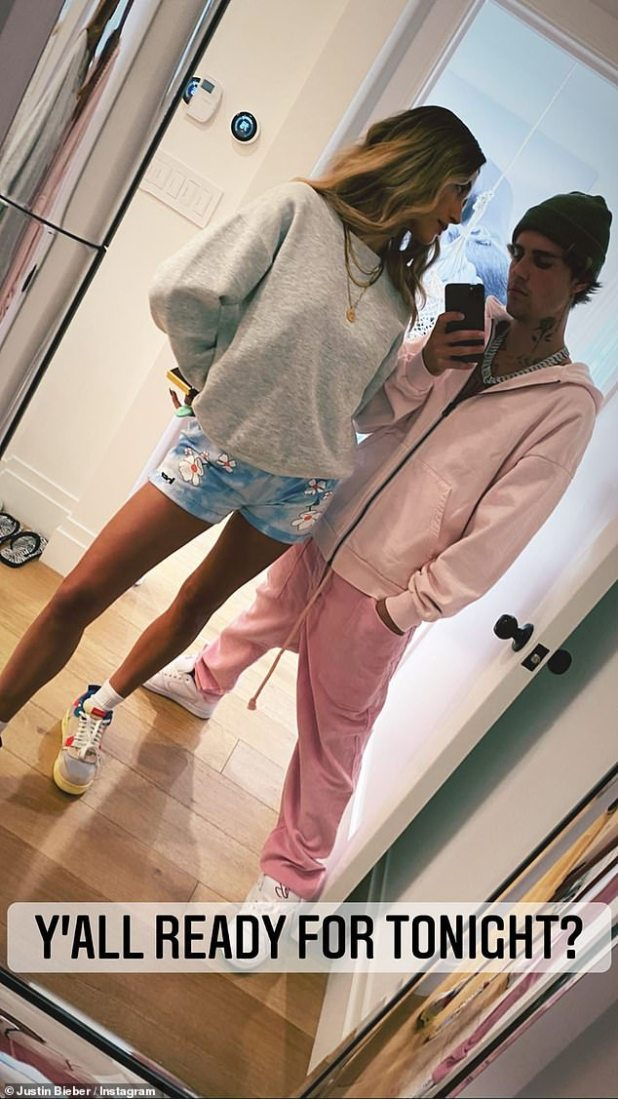 Tease: Once back at home, he made a third outfit change to take a mirror selfie with his model wife.  'Ready for tonight?'  He wrote his upcoming video premiere with the picture