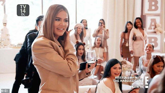 Eager:The youngest Kardashian kept looking at the ballroom's entrance to see if Malika had arrived; in the background is Kylie