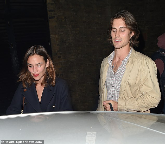 Handsome: Meanwhile, her partner looked handsome in a patterned button down shirt, over which he donned a beige utility style jacket