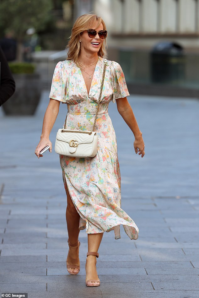 Designer: She shielded her eyes from the late September sun with cat-eye tortoise shell sunglasses and accessorised her look with a white £1,890 Gucci Marmont handbag