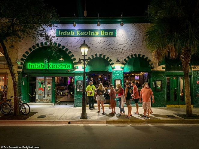 Patrons wait outside Irish Kevin's Bar And Restaurant in Key West