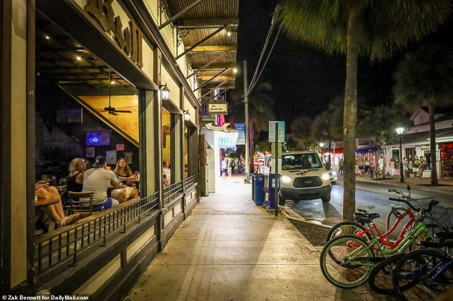 Duval Street is seen rather mellow in Key West as over 2,000 people tested positive and 152 died on Wednesday across Florida