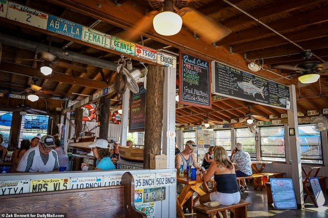 Patrons drink and eat inside at Half Shell Raw Bar in Key West