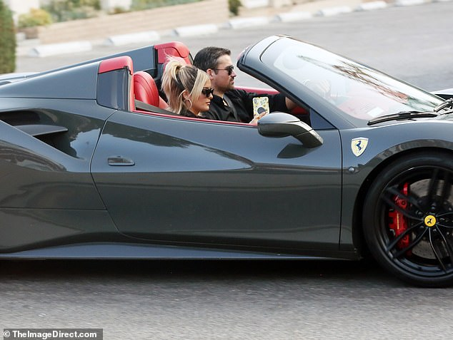 Cruising: Bebe and her boyfriend took a grey Ferrari out for a spin, stopping at a smoke shop along the way