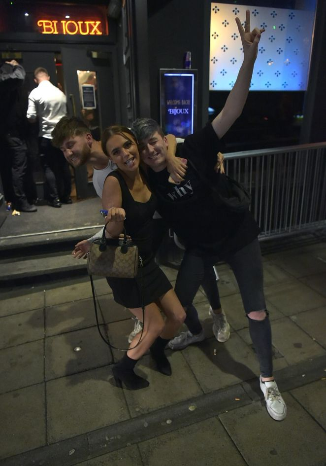 Three friends joke around as they leave a pub in Newcastle this evening. The new curfew in the city has been imposed by the government after a rise in coronavirus cases
