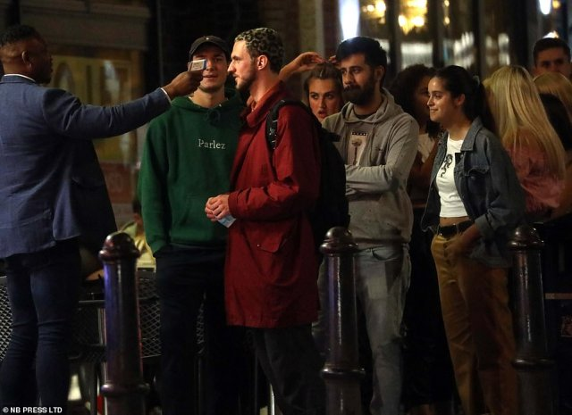 Crowds of young people queue up to go into a bar in Leeds as people took the opportunity to let their hair down