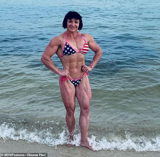 Hard to handle: Oksana said men are often jealous of her bulging muscles
