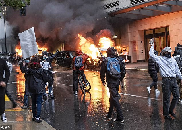 While the May 30 protests were mostly peaceful, some vehicles were set on fire, pictured