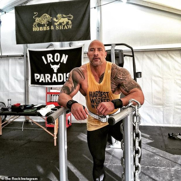 No Excuses: To prevent 'hundreds of production crew members from waiting' on him, the wrestler-turned-actor pushed, pulled and ripped the gate until he descended through a brick wall on Friday.
