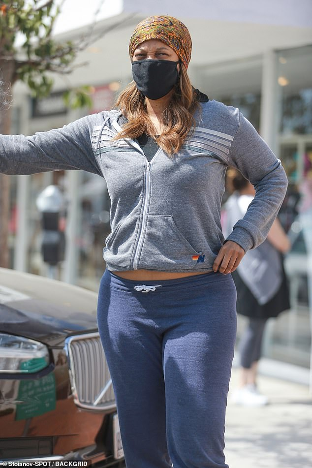 Comfy:The former America's Next Top Model host wore blue capri sweats, with a zip-up grey sweatshirt and colorful flip-flop sandals