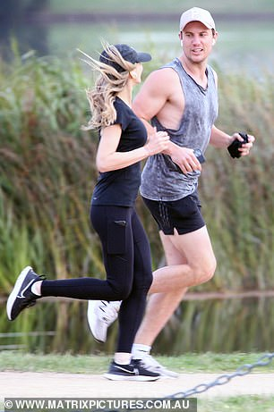 Pounding the pavement: Nadia had no problems keeping up with her athletic beau as they jogged through the park