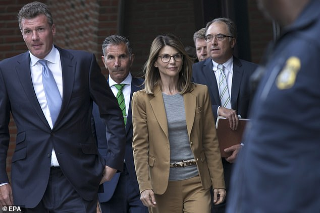 Months-long legal battle: This May, Lori pleaded guilty to one count of conspiracy to commit wire and mail, leading to her being sentenced to two months in jail; seen in April of last year