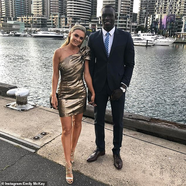 Daw (pictured with partner) is one of 11 players let go from the club's roster this week in an overhaul following a poor 2020 season which sees them in contention for the wooden spoon