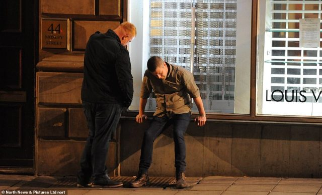Two men pictured in Newcastle last night as bars closed at 10pm after the Government put the North East into lockdown