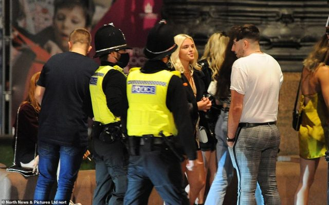 Police officers wearing face masks were out in force in Newcastle city centre as bars closed at 10pm last night