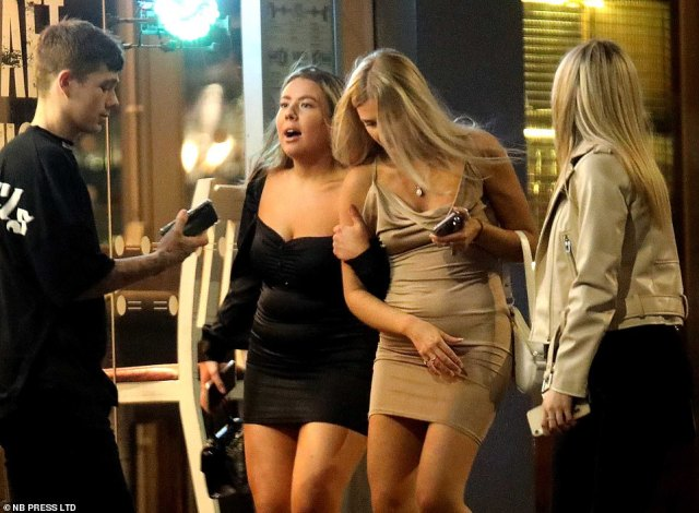 Two revellers pictured in Leeds city centre on Friday night as the city recorded its highest ever daily increase of Covid cases