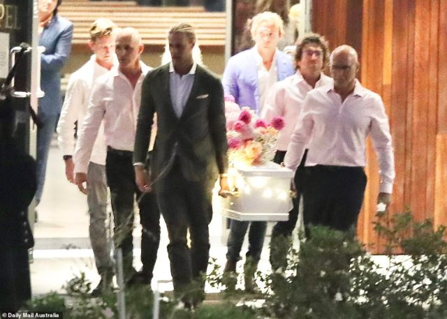 Jaimi Kenny's brother Jett (pictured front left) can be seen leading the pallbearers as they carrying her casket out of the church