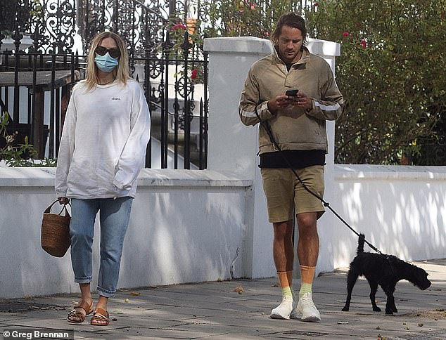 Smitten: Margot Robbie and her husband Tom Ackerley, both 30, looked as smitten as ever on Friday, when they were spotted enjoying a relaxed stroll in London