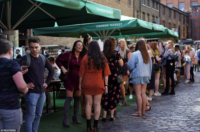 The Prime Minister announced that he was creating a new legal duty for people to self-isolate if they test positive for the virus. Pictured: People wandering through Stables Market earlier today