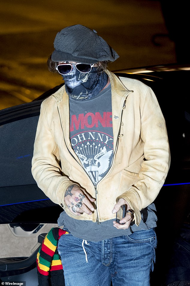 Here is he:The actor, 57, opted for a typically quirky look as he arrived wearing a Ramones T-shirt and a baker boy style cap with aviator shades