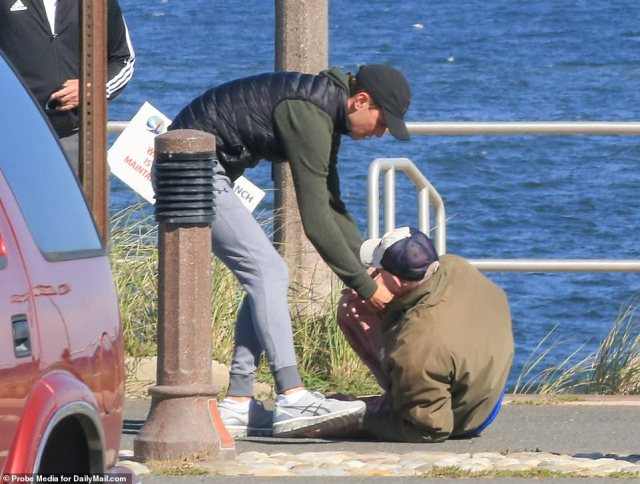 Pictured: Senior Advisor Jared Kushner (left) helped a man off the concrete on Saturday after the man accidentally fell