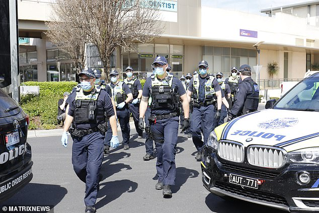 Police swarmed into the centre (pictured) but the demonstrators had already fled the scene