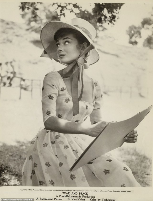 The Hollywood actor was said to be so fond of the photographs that she kept them for the rest of her life (Another shot taken when Hepburn was working on the film shows her dressed in a floral dress and bonnet)