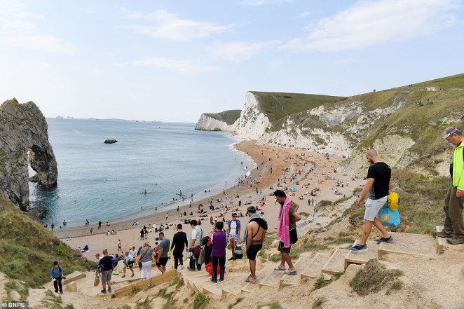 Visitors turned out at Durdle Door on the Dorset coast this afternoon to enjoy the sunshine before 'autumn proper' arrives next week